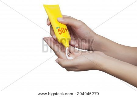 woman applying sunscreen on her hand isolate on white background with clipping path. SPF 50 and PA sunblock protection concept. Travel vacation