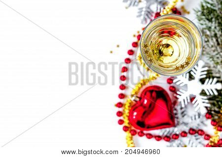 glasses of champagne and Christmas ornaments top view on white background.