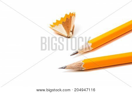 Two Pencils with sharpening shavings on white background. stationery. Isolated Office tool. Two yellow pencils isolated on white.