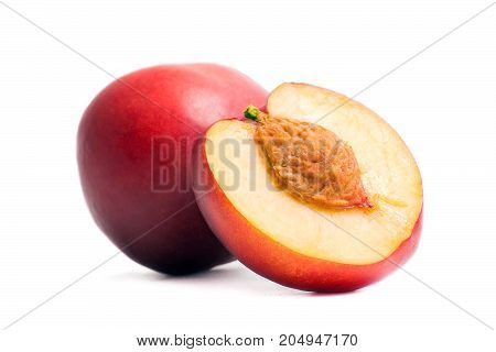 Nectarine whole and half of nectarine with a stone. Isolated nectarines on a white background. Summer juicy fruit. Healthy food. Bright juicy colors.