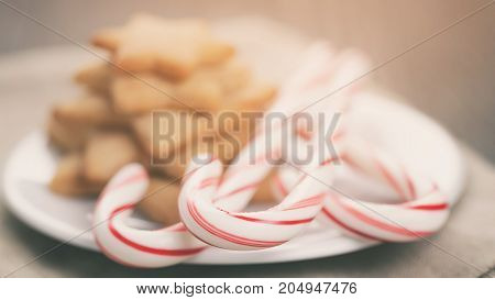 holiday cookies and candy canes on wood table,  rustic photo