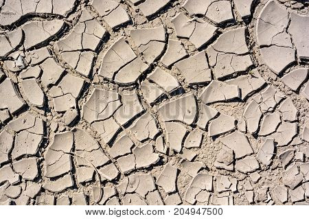 Horizontal texture of cracked dry land in a desert