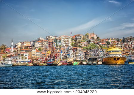 ISTANBUL TURKEY: Fishing boats moored in the small fishing harbor Sariyer on April 16, 2015