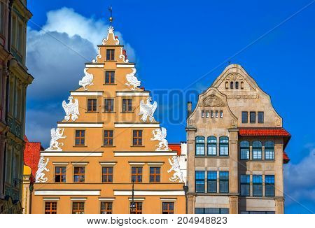 Wroclaw/Poland- August 17, 2017: old town Market Square - architectural details - building facade, decorated with city heraldic  figures - crowned lion and eagle.