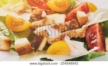 homemade caesar salad with chicken, shallow focus