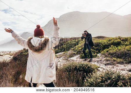 Man Taking A Pictures Of His Girlfriend On Vacation