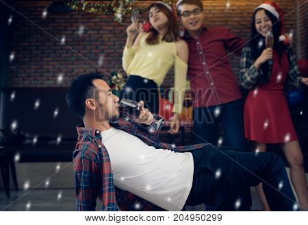 Young men and women group chrismas party together with drink and drunk dancing step show happy and fun in new year