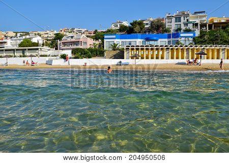 Kavala Greece - July 11 2017: Vacationers on Kavala beach at sunny summer morning.