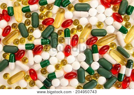 Pills Background. Heap Of Medicine Tablets And Pills Different Colors On White Background. Healthcar