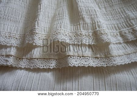 Hem Of The Skirt With Frills And Lace