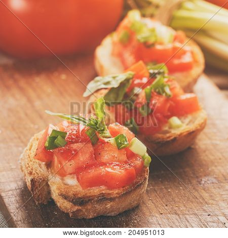 Italian bruschetta with tomatoes onion and basil, rustic food