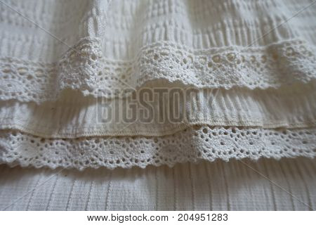Lace Ribbons Stitched To Frills On Hem Of The Skirt