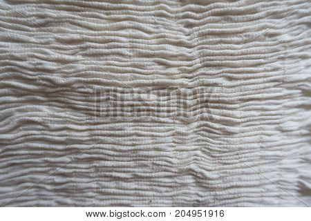 Vertical Rows Of Gathers (shirring) On Beige Fabric