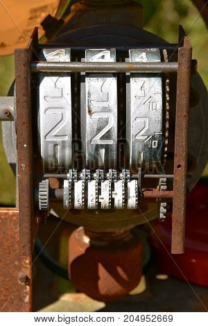 Inside an old gas pump the dials are displayed which indicate the cost per gallon of gas