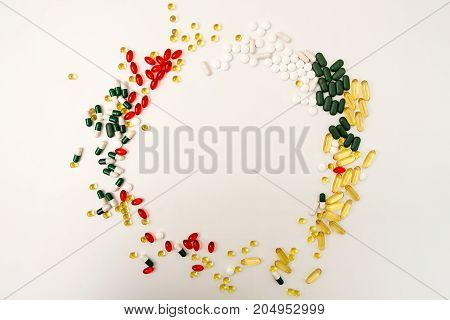 Pills Background. Circle Of Assorted Various Medicine Tablets And Pills Different Colors On White Ba
