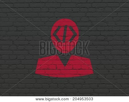 Software concept: Painted red Programmer icon on Black Brick wall background