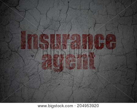 Insurance concept: Red Insurance Agent on grunge textured concrete wall background