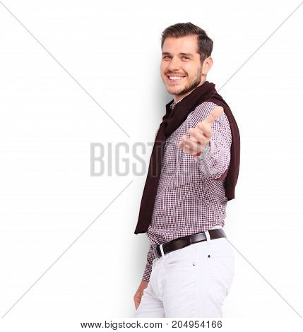 Happy smiling young man presenting and showing your text or product isolated on white background