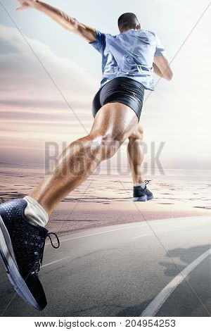 Sport backgrounds. Sprinter starting on the running track. Collage. Advertising concept. The male athlete running against sea beach