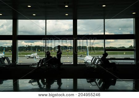 business travel silhouettes of unrecognizable walking people in the airport.