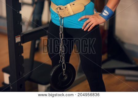 Bodybuilding. Strong Fit Woman Stand In A Gym With Weight
