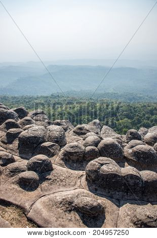 The knob stone ground near the cliff with the light fog in the national parkphitsanulok province Thailand.