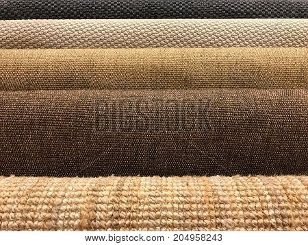 Samples of brown woven sisal and natural fiber carpet roll for texture and background