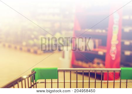 View From Shopping Trolley Into Abstract Blurred Supermarket Aisle Background With White Tone For Co