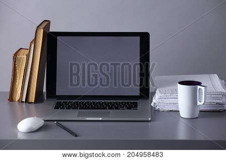 Workspace with computer and documents in office .