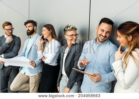Group of young perspective designers discussing in office
