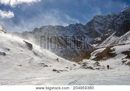 Man looking away and thinking in snow mountain hill scenery - with copyspace