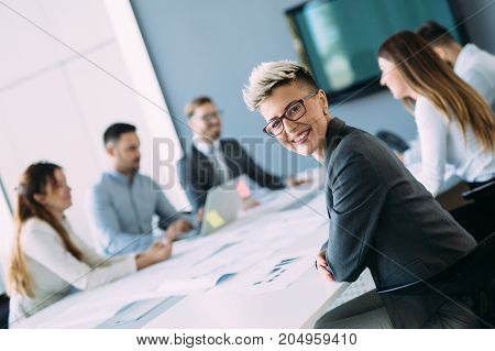 Portrait of young smiling female architect on meeting