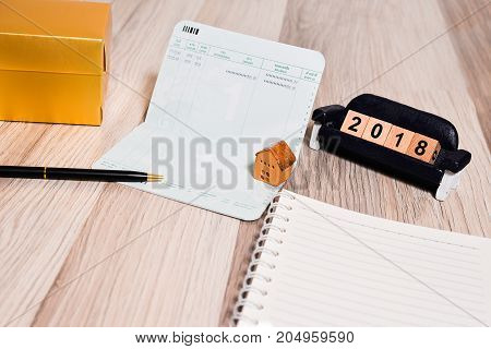 The empty book bank with 2018 new year cubes and home model finance planning concept
