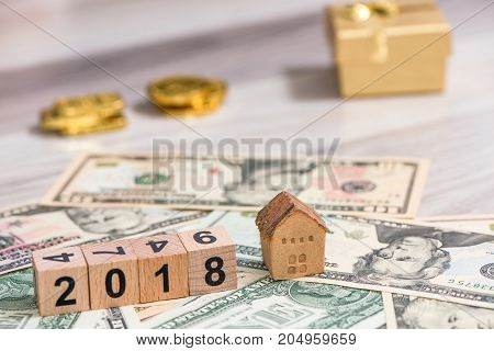 2018 new year cubes with the house model on group of cash and the gold gift