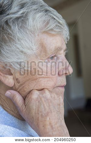 Close up image of a senior woman looking worried and concerned