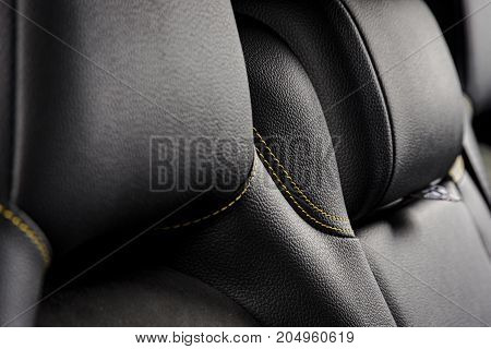 Modern race car interior. Sport seat details, black leather with yellow stitch