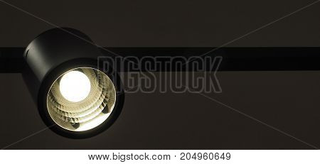 Lamp energy saver black color design is modern Lighting is daylight in the shop Photo for background has copy space.