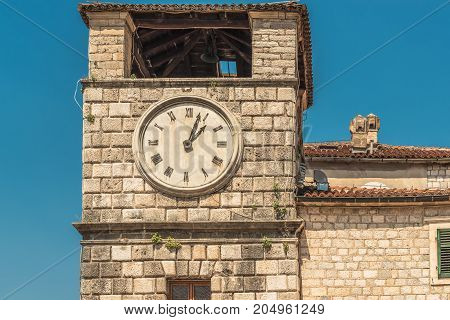 The Clock Tower on the Square of Arms in the Old Town of Kotor, Montenegro. The Old Town of Kotor is a UNESCO World Heritage site and a famous tourist attraction.