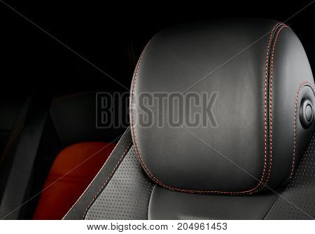 Modern race car  black and red perforated leather interior. Part of  leather car seat details.