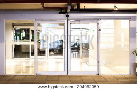 Blank sliding glass doors entranceat airport.Glass doors in an office