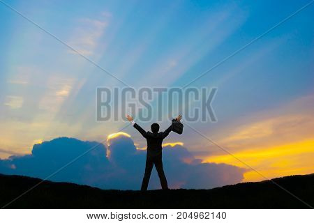 Businessman stands up hand cloud background and sunlight