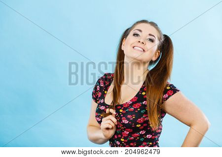 Education teenage adolescence happiness concept. Happy teenager student girl with ponytails having fun poster