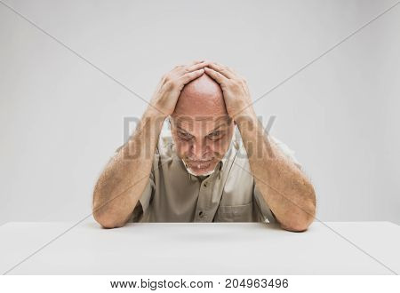 Despondent Senior Man Sitting Thinking