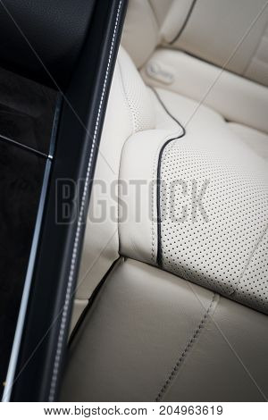 Back passenger seats in modern luxury car, car interior details