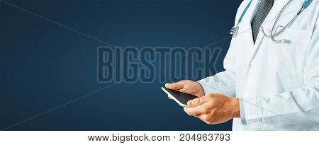 Man Doctor Using Digital Tablet With Copy-Space