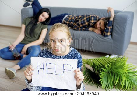 Husband has an alcohol addiction and daughter holding help sign