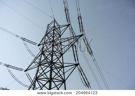 Power Tower pole electricity close up with cloudy dark sky low angle view industry