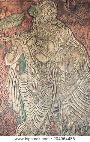 Lord Krishna depicted on a wall decoration resembles an ancient art