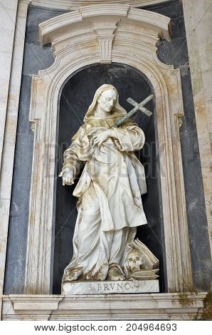Mafra Portugal - June 1 2017: Statue of Saint Bruno by sculptor Giuseppe Lironi inside Basilica de Nossa Senhora e Santo Antonio de Mafra. Ecclesiastical writer and founder of the Carthusian Order