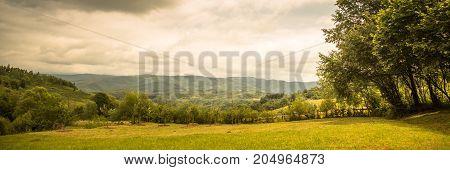 Idyllic landscape in mountains. Rural scene. Long format